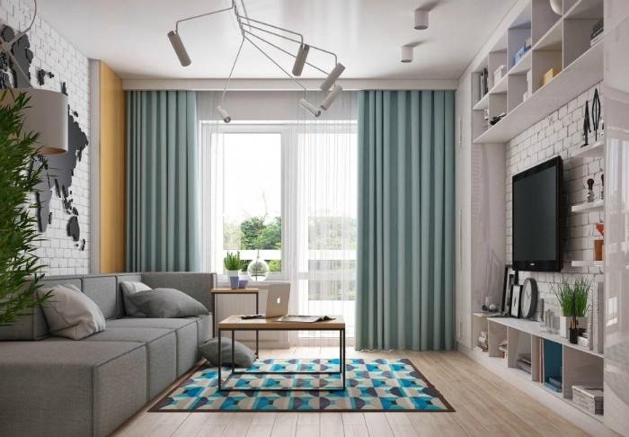 Стильная гостиная с кирпичными стенами.