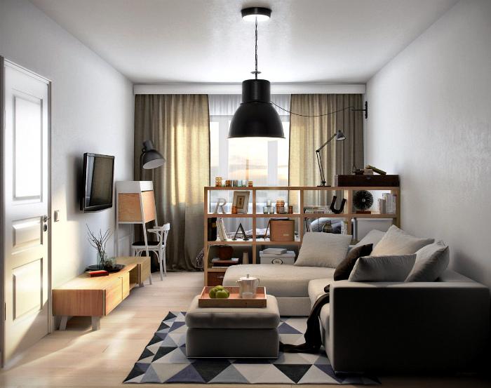 Однокомнатная квартира, зонированная при помощи перегородки.