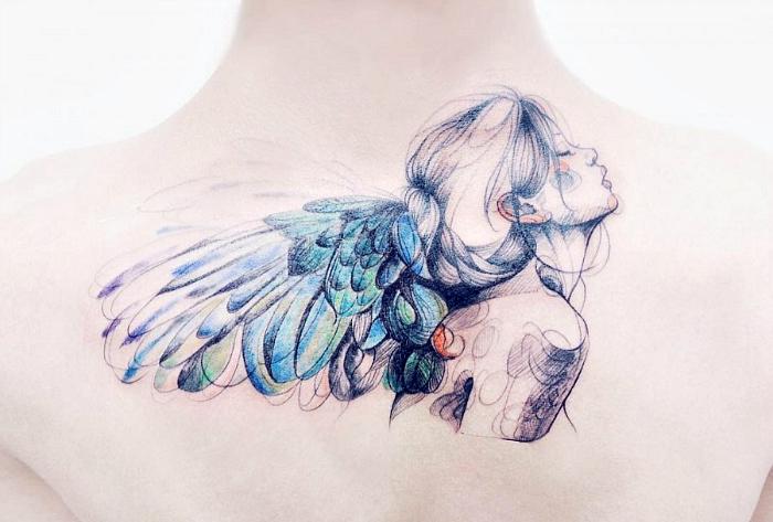 Акварельная татуировка с изображением ангела.