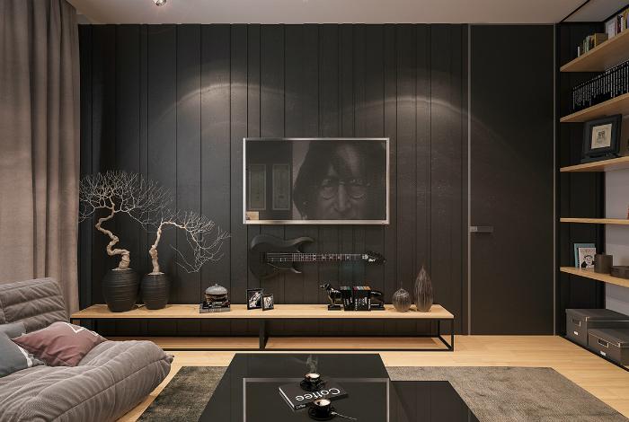 Гостиная с черными стенами и обилием элементов из светлого дерева.