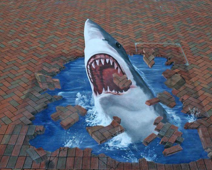 Огромная белая акула, пожирающая асфальт.