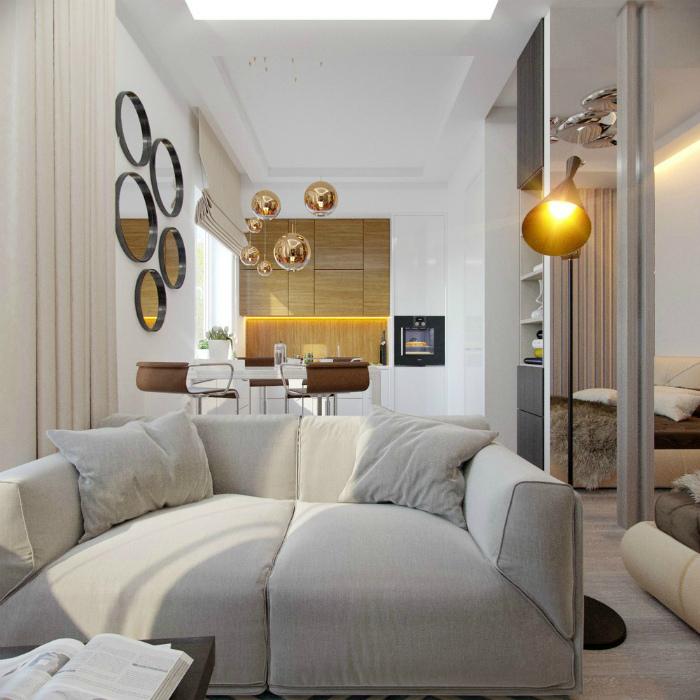 Элегантная кухня-гостиная, оформленная в нейтральных тонах.