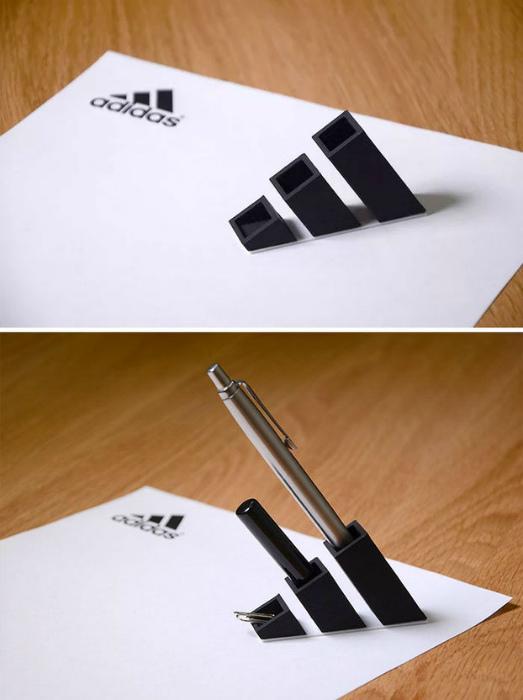 Логотип спортивной фирмы Adidas.