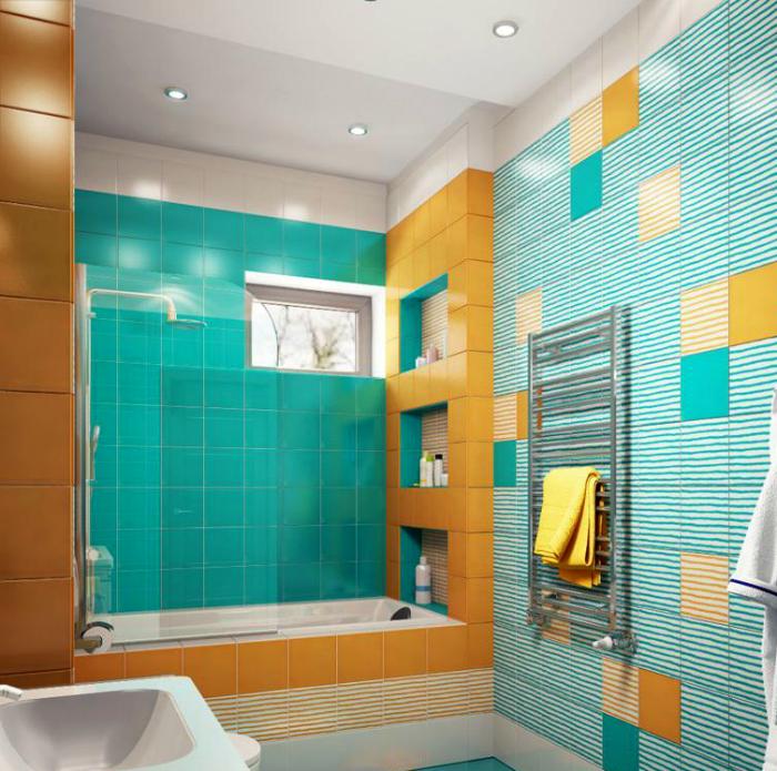 Сочетание желтого и бирюзового в интерьере ванной комнаты.
