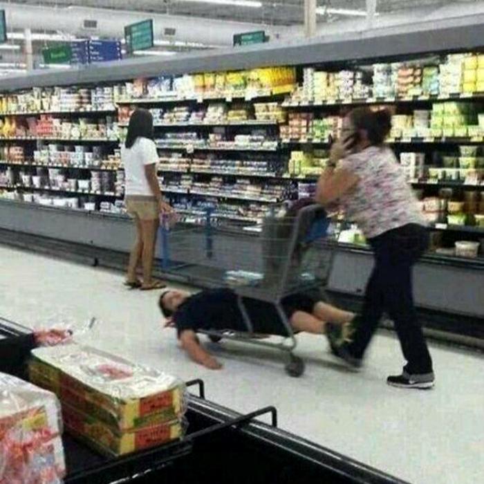 Этот парень совсем юный но уже ощутил на себе, что такое шоппинг с женщиной.