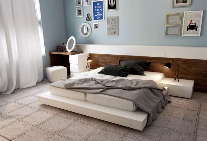 Просторная спальня в бело-серых тонах.