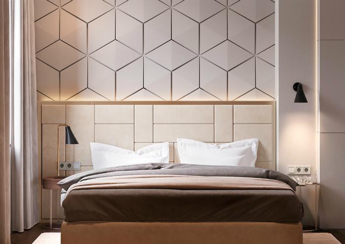 Светлая спальня с текстурной стеной.