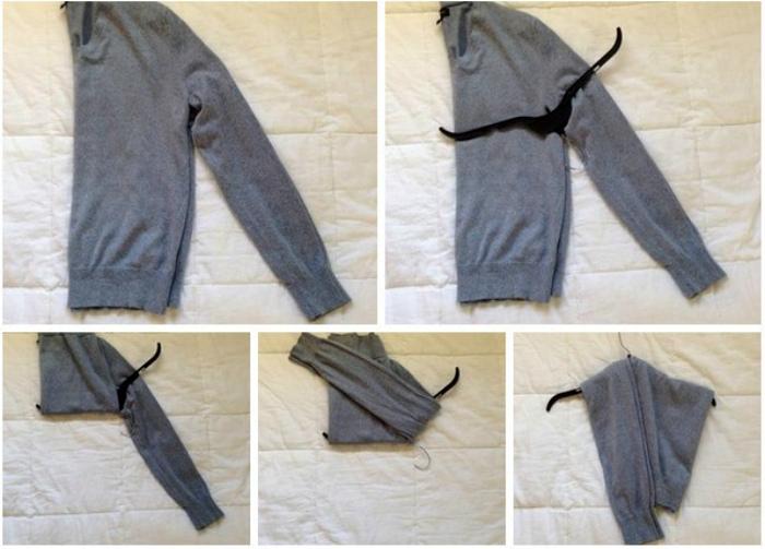 Кофты и свитера на вешалках.