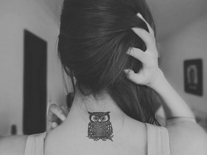 Татуировка с изображением совы.