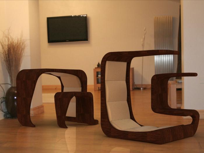 Этот замысловатый куб может быть комфортным креслом с мини-столиком, а если перевернуть - столом и табуретом.