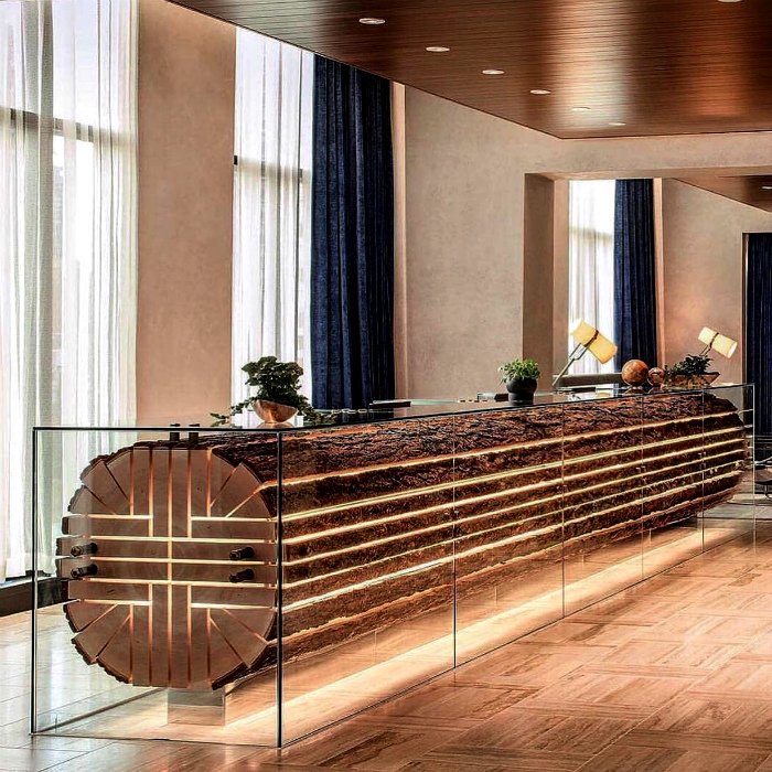 Стойка регистрации из стекла и дерева. | Фото: DesignLibero.