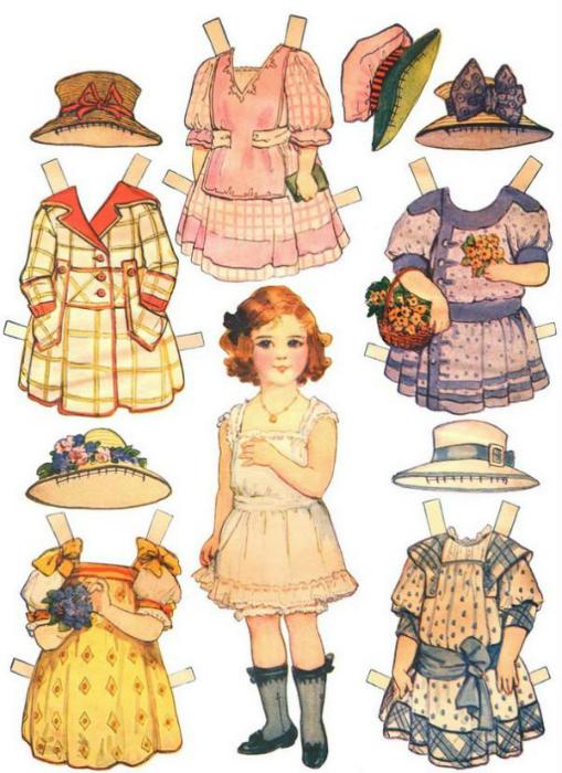 Бумажные куклы и их гардероб, который следовало аккуратно вырезать.