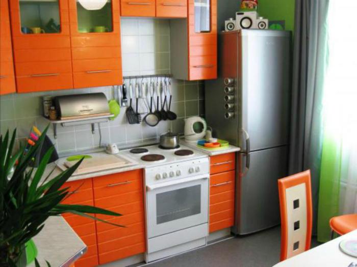 Оранжевые шкафчики в интерьере.
