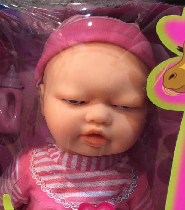 Печальная кукла.