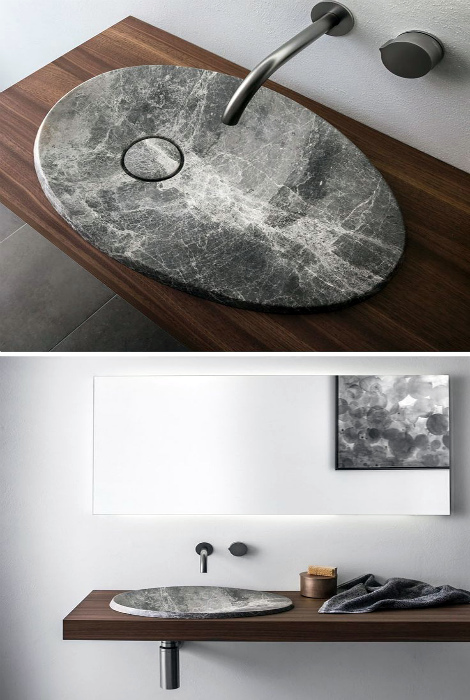 Плоская раковина из камня.