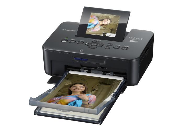 Надежный принтер под названием - Canon Selphy CP910.