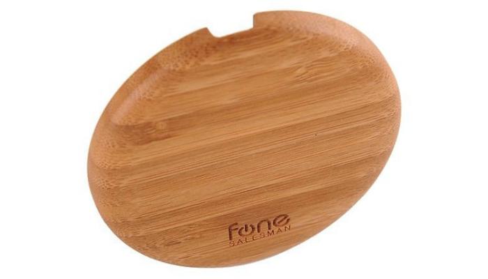 Удобная бамбуковая зарядка для телефона под названием - Woodpuck.