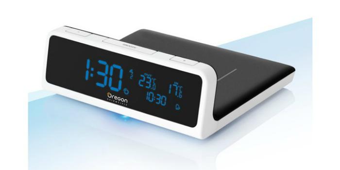 Многофункциональный девайс для беспроводной зарядки мобильного телефона под названием - Oregon Scientific Time & Wireless Charging Station QW201.