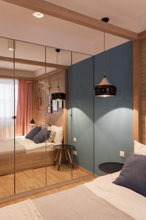 Зеркальный шкаф-купе визуально расширяет комнату