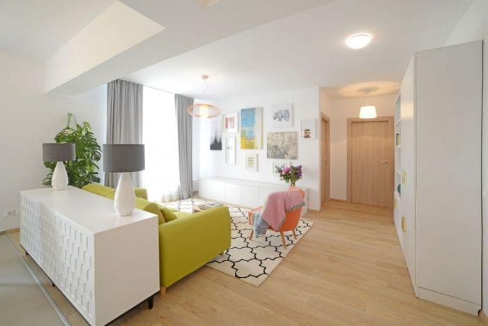 За счёт объединения кухни и гостиной получилась одна просторная комната