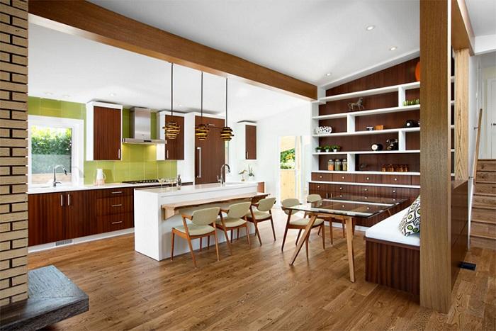 Шоколадный интерьер с добавлением зеленых ноток, украшает эту кухню.