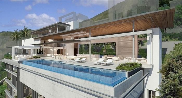 Уникальный дом с феноменальным фасадом, создающий обширные жилые платформы с непревзойденным видом на побережье Атлантического океана.