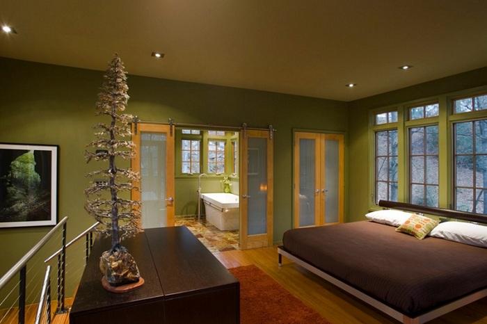 Симпатичный интерьер с раздвижной дверью в зеленых тонах станет отличным решением для создания особенного интерьера.