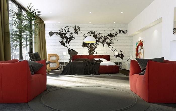 Интересный акцент спальной в стиле лофт - карта на кирпичной стене, что выглядит очень привлекательно.