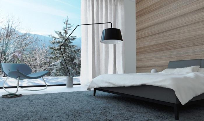 Спальня в минималистском стиле с красивым зимним видом из окна подарит волшебное настроение.