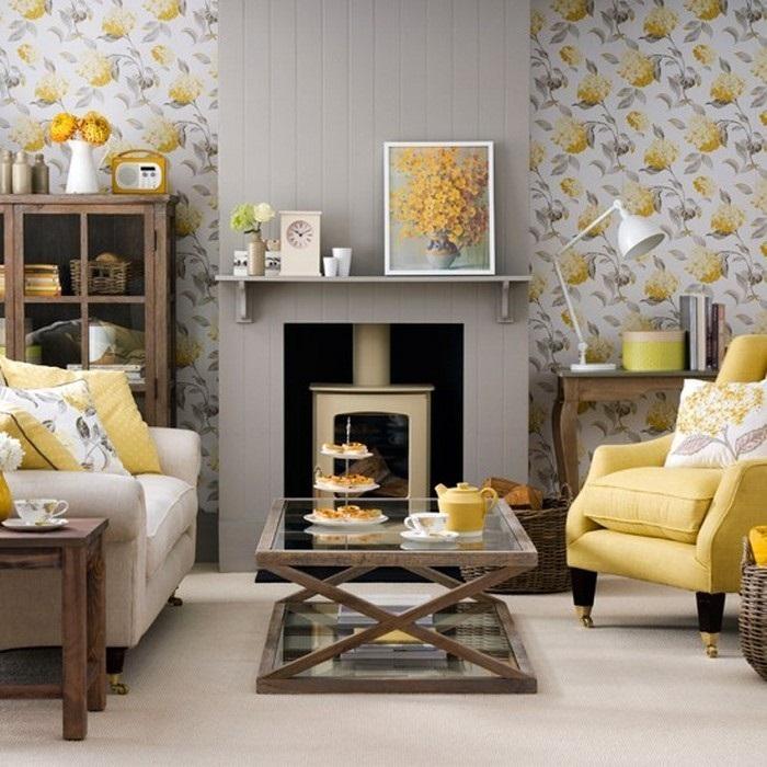 Симпатичный интерьер гостиной в желто-серых тонах, что позволяет создать полную свободу в декорировании комнаты.