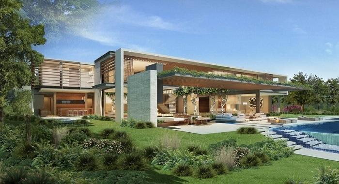 В пышном пригороде в Кейптауне, Южная Африка, этот павильон в стиле Хаус, переплетается с экзотическими двориками.