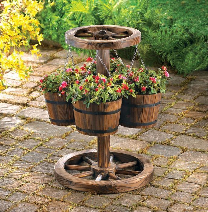 Один из самых лучших вариантов для декора сада - держатель горшков для любителей садоводов.