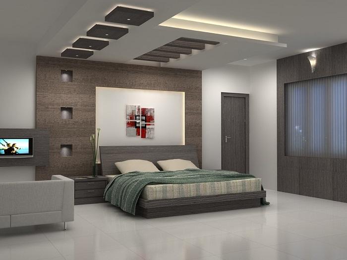 Стильный интерьер в оттенках серого, что выглядит очень интересно особенно за счет интересного потолка.