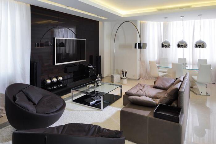 Современный привлекательный интерьер небольшой гостиной в рамках помещения с открытой планировкой.