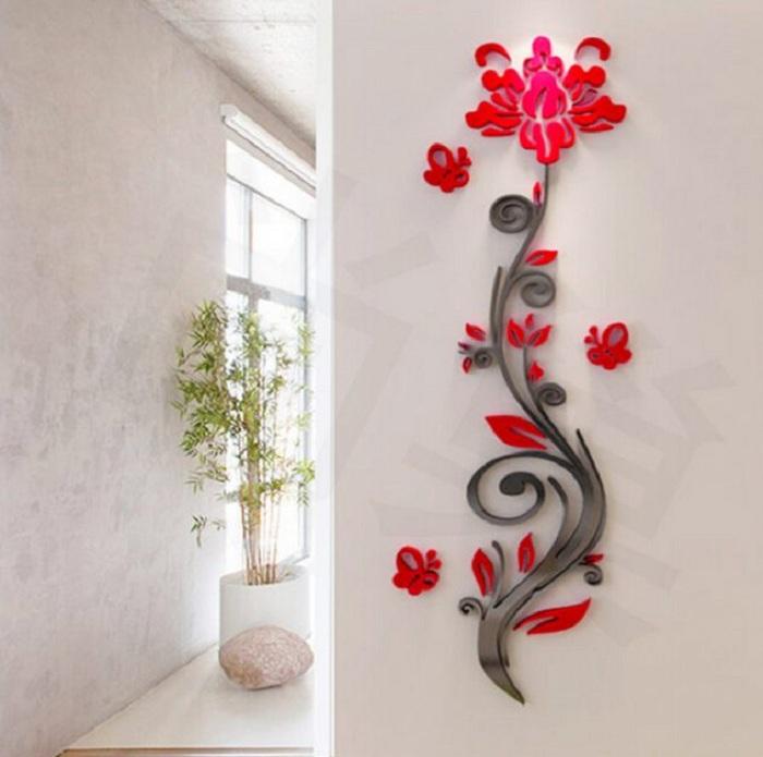 Интересный вариант оформить стену 3D наклейками в виде ярких алых цветов, которые создадут невероятно яркое настроение.