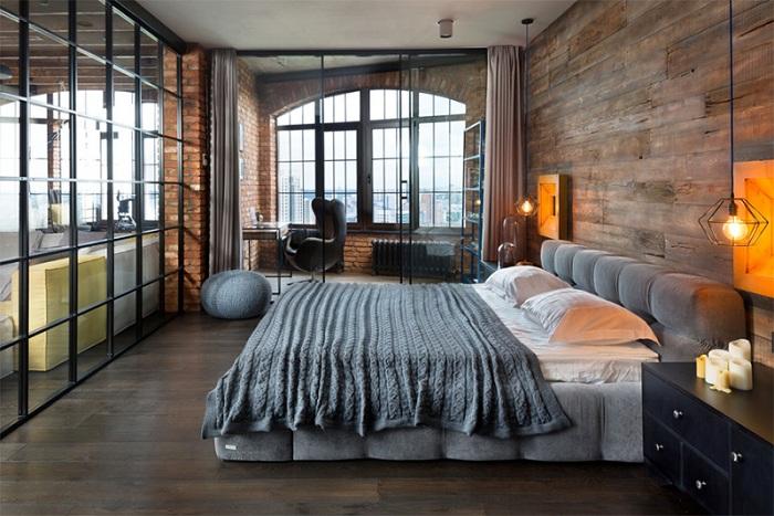 Интересная кровать в этой спальной добавляет своеобразного настроения, дополняет общую картину деревянными стенами.