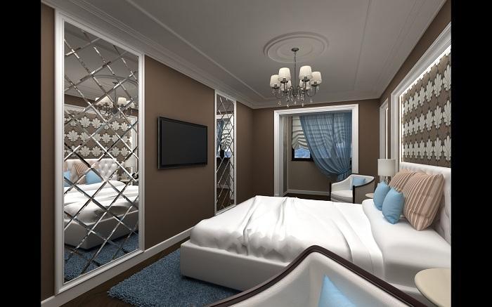 Интересное сочетание кофейного и белого в цветах комнаты с зеркалом на стене необычной формы создает по-своему интересную атмосферу.