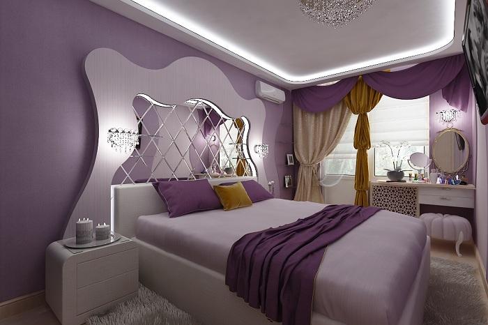 Спальня выполнена в фиолетовых тонах, что придает ей ноток нежности в дополнении с шикарным зеркалом у изголовья кровати.