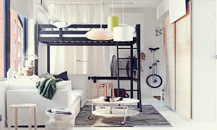 Оформление мини-спальни с кроватью в темных тонах, что выглядит весьма прилично.