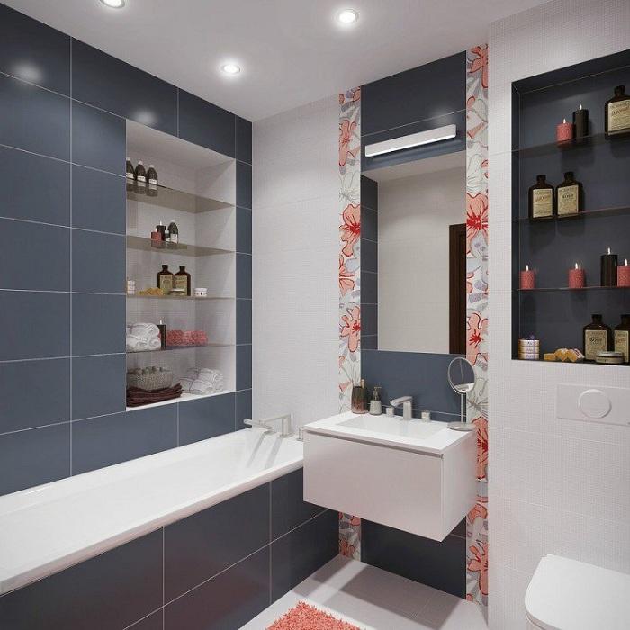 Інтер'єр ванної-кімнати перетворений за рахунок кольорових вставок на кахлі, що виглядають чудово.