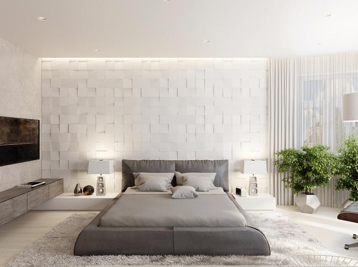 Хорошее решение для комфортного декорирования комнаты с помощью оформления стены в светло-сером цвете.