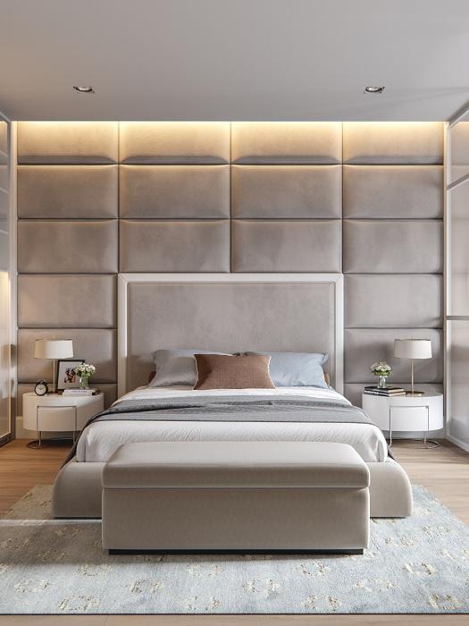 Серый интерьер спальной с крутой мягкой стеной, что точно понравится.