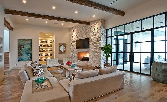 Красивый интерьер гостиной оформлен в нежно-кремовых тонах.