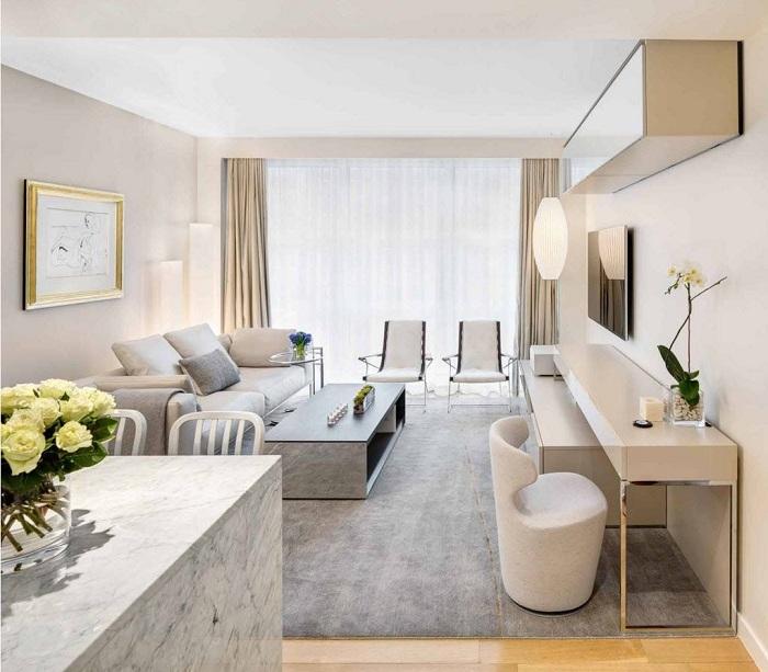 Отличный пример декорировать интерьер гостиной с помощью лучших современных тенденций.