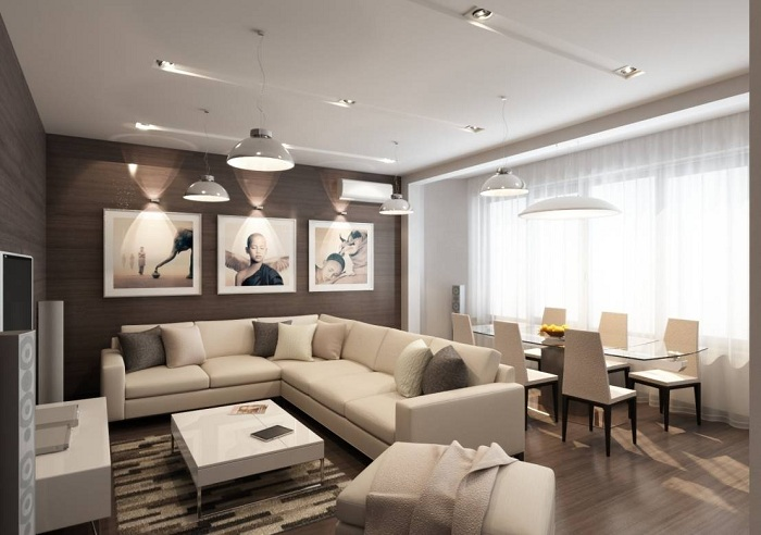 Крутий приклад оформити інтер'єр вітальні в ніжно-вершкових тонах, що створять теплу обстановку в кімнаті такого плану.
