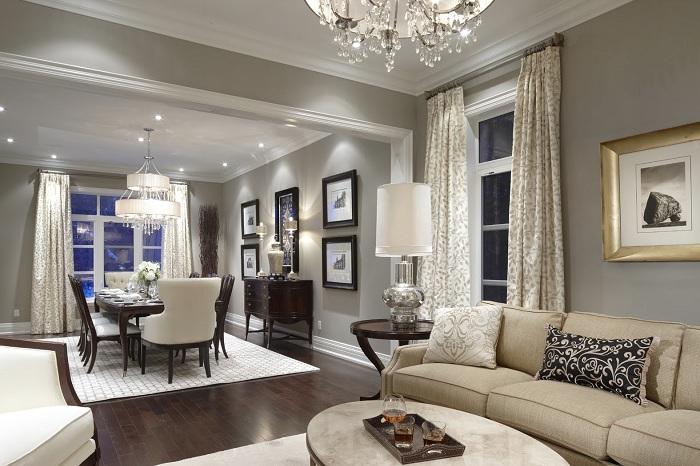 Отличный пример оформления интерьера гостиной в нежно-кремовых тонах.