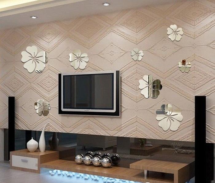 Симпатичное преображение комнаты за счет оригинальных элементов декора и размещения в ней телевизора.