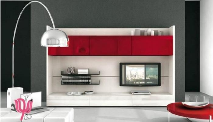 Интересная цветовая гамма гостиной с красивым телевизором и незабываемым интерьером.