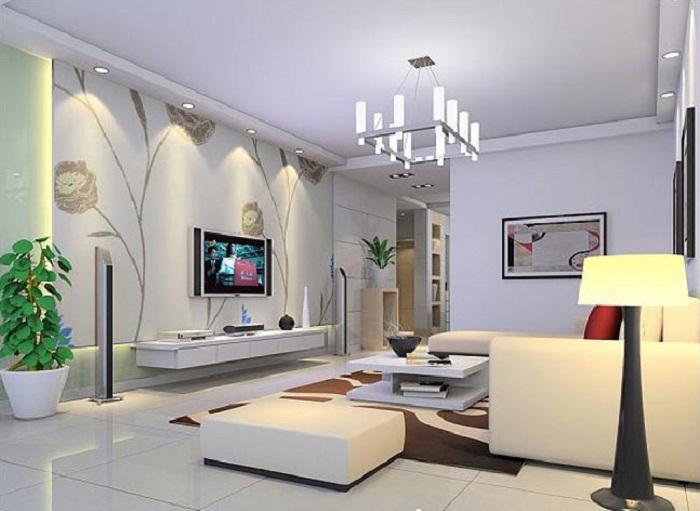 Очень красивый интерьер гостиной с телевизором и 3D-обоями, что выглядят очень симпатично.