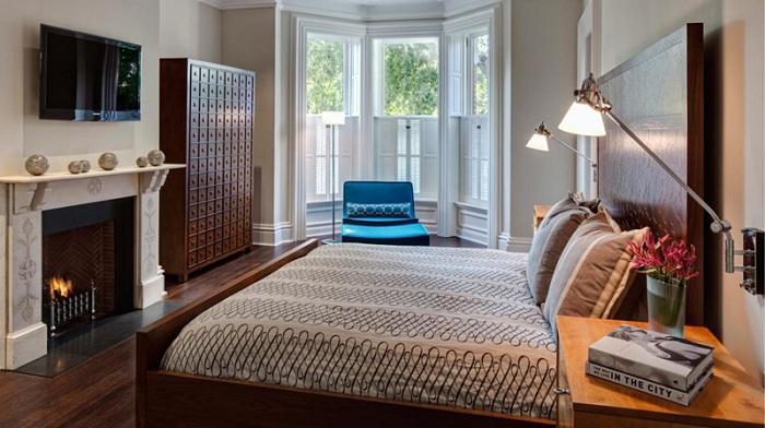 Интересные кофейные оттенки в оформлении интерьера спальной, то что придется по вкусу многим.